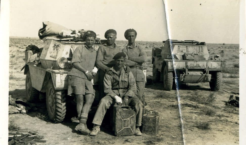 Hector Duff (seated) in the Western Desert with three comrades, around the time of his Military Medal award