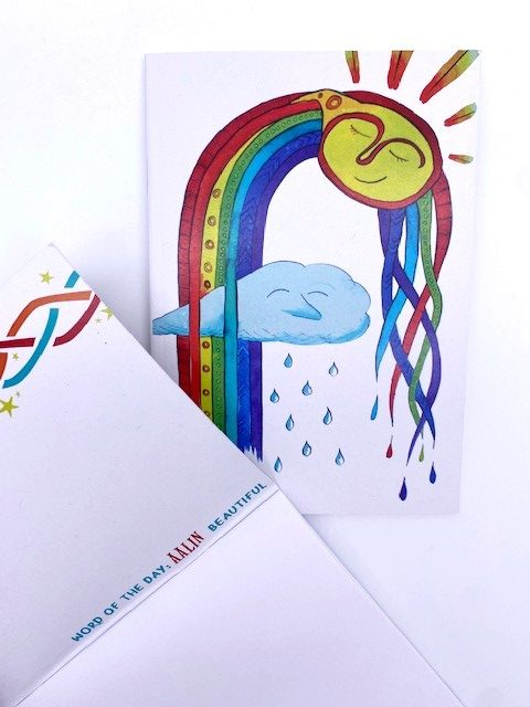 Notebook with a rainbow illustration